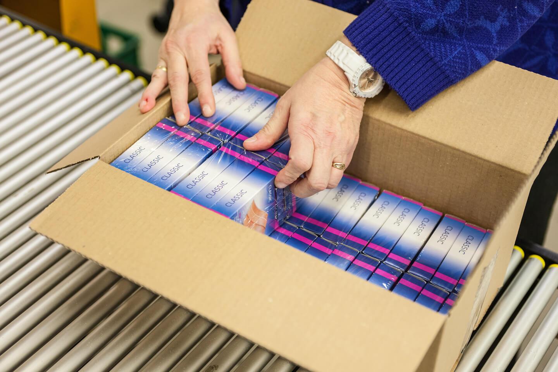 Kwalitatief ompakken van goederen